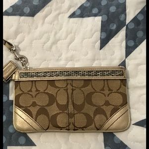 Coach Wristlet. Gold and tan.
